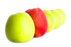 Five apples in a row. One red apple in the focus and four green ones defocused in a row. Choose your apple Stock Image