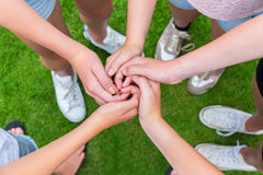 Five arms with hands of children entangled Royalty Free Stock Images