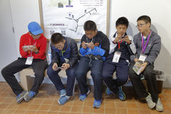 Five Asian Boys look into their cell phone after museum visit to Château de Fontainebleau, Paris, France - shot August 2015 Stock Images