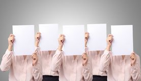 Five Asian business woman cover her face with blank empty white paper for hide emotion.  stock photography