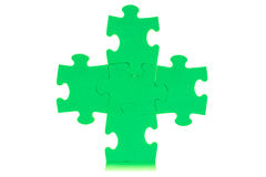 Five attached green puzzles Royalty Free Stock Photo