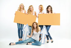 Five attractive women holding boards and arrows Stock Photography