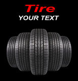 Five automobile rubber tires on black Royalty Free Stock Image