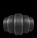 Five automobile rubber tires isolated on black Royalty Free Stock Images