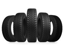 Five automobile tires. Isolated on white background Stock Image