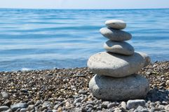 Five balanced stones on a beach Stock Image