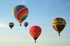 Colorful balloons in sky. Five colorful balloons floating in blue sky Royalty Free Stock Image