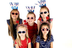 Five beautiful children wearing patriotic headbands and dark glasses Stock Image