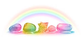 Five Beautiful Rainbow Healing Crystals. Four rainbow coloured healing crystals and a merkabah laid in a row on a white background with a rainbow arcing above stock images