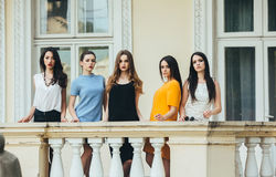 Five beautiful young girls in dresses Stock Images
