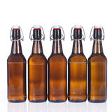 Five beer bottles in a row Stock Photo