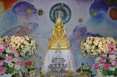 Five golden sitting Budddha Image. Five golden sitting buddha image and mural painting at wat pha sorn kaew Thailand stock photography