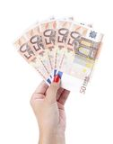 Five bills by 50 euros in woman hand. Stock Images