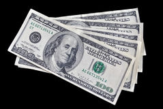 Five bills on one hundred dollars. On black background Royalty Free Stock Images