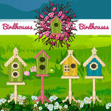Five birdhouses on a landscape background Stock Image