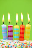 Five birthday candles. On green background Stock Photo