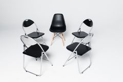 Five Black Chairs in a circle isolated on white background royalty free stock image
