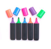 Five black color markers with open caps isolated Stock Image