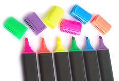 Five black color markers with open caps on white b Royalty Free Stock Photos