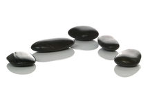 Five black pebbles Stock Photography