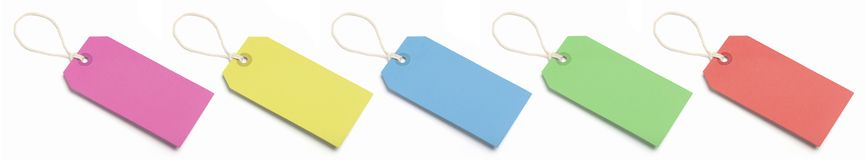 Five blank, coloured tags. Stock Photography