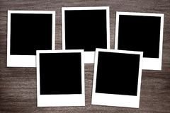 Five blank instant photo print templates on wooden background Stock Photography