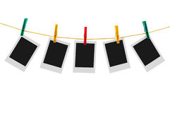 Five blank instant photos on clothesline Royalty Free Stock Image