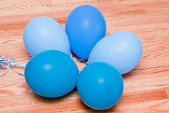 Five blue balloons on floor in a circle Stock Image