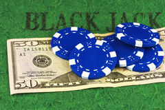 Five blue chips lie on a bill fifty dollars Royalty Free Stock Image