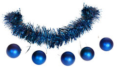 Five blue christmas balls on the tinsel Stock Photo