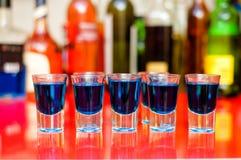 Five blue curacao alcoholic shots on bar Stock Photo