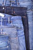 Five blue jeans Stock Image