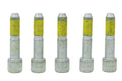 Five bolts for the car with the yellow glue on the threads Royalty Free Stock Photos