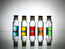 Five bottles with different coloured substance Stock Photos