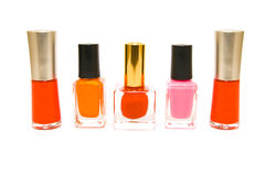 Five Bottles of Nail Polish. Five bottles of red, pink and orange nail polish on a white background Stock Photography