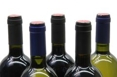 Five bottles of wine. Necks of 5 bottles of wine on white background royalty free stock photography