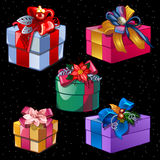 Five boxes of different colors and shapes Royalty Free Stock Photography