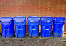 Five Bright Blue Recycle Bins. Line up of recycle bins outside of college cafeteria Stock Image
