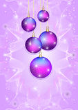 Five bright Christmas balls on a light purple back Royalty Free Stock Photo
