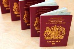 Five British United Kingdom European Union Biometric passports s. Tanding in a row Stock Photo