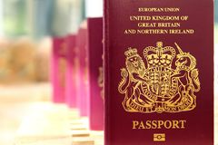 Five British United Kingdom European Union Biometric passports s. Tanding in a row in shallow focus Royalty Free Stock Photos