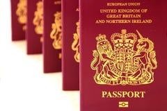 Five British United Kingdom European Union Biometric passports s. Tood as if queueing Stock Photos