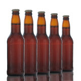 Five Brown Beer Bottles Royalty Free Stock Photo