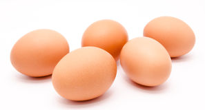 Five brown chicken eggs isolated on a white background Stock Photos