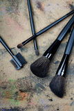 Five brushes on a dingy background. Close-up photo of five brushes on a dingy background Stock Photo