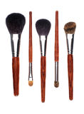 Five brushes in parallel on white background Royalty Free Stock Images