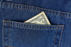 Five bucks in jeans pocket Royalty Free Stock Photography
