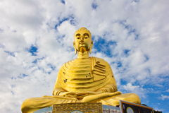 The golden buddha statue on blue sky. At Prachuab kirikhan, Thailand Stock Photo