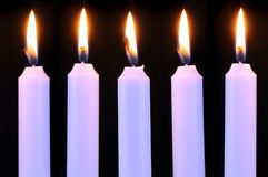 Five Burning Candles on Black Background Stock Photo