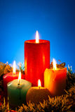 Five burning colourful candles Stock Photography